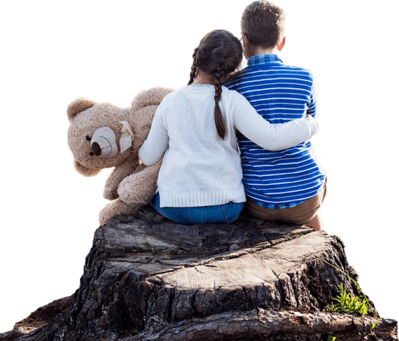 brother and sister hugging on a tree stump