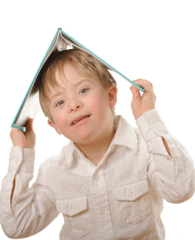 Child with Down syndrome holding a book over his head