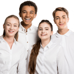 group of teenagers wearing white shirts, smiling and facing the camera
