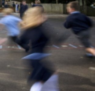 children racing past camera in school playground