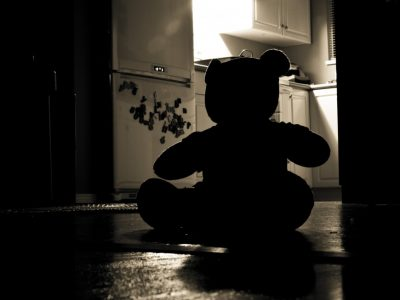 silhouette of teddy bear in a kitchen in the dark