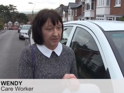 Wendy works as a carers in an agency she is pictured by her car who uses the current parking permit scheme