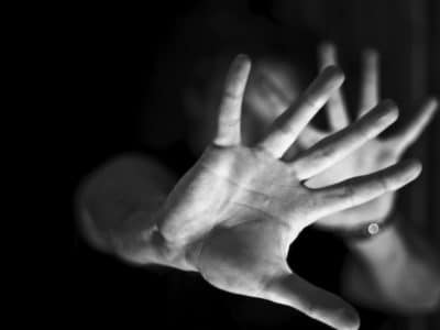 Hands against black and white background