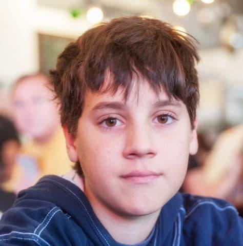 teenage boy looking at the camera