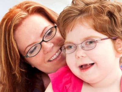 woman smiling with young girl