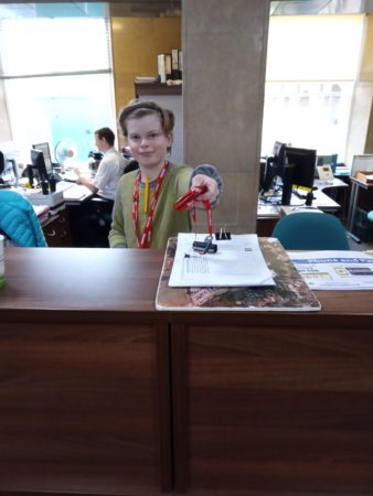 Young person helping out behind reception at County Hall