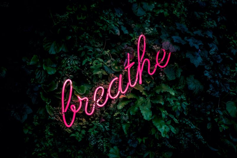 The word 'Breathe' set against a dark background