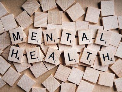 "Scrabble tiles spelling out ""mental health"""