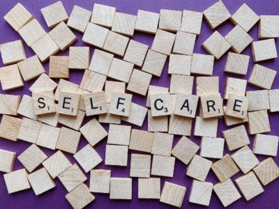 """Scrabble tiles spelling out """"self care"""""""""""