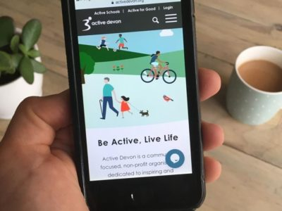 a smartphone showing the Active Devon live chat feature