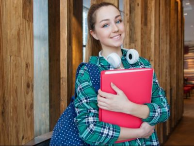 a female student holding a folder